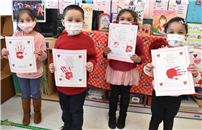Students with valentine's day projects thumbnail180531