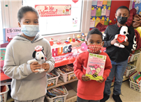 Students with valentines day books thumbnail180646